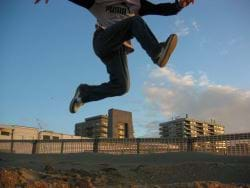 Man jumping in the air on a beach