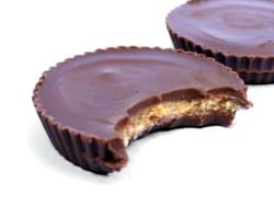 Two Reese's Cups with one bitten