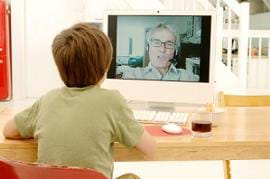 Child watching Grand-dad on webcam
