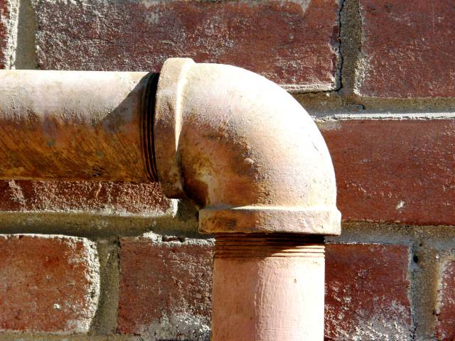 Pipe against a wall bending south