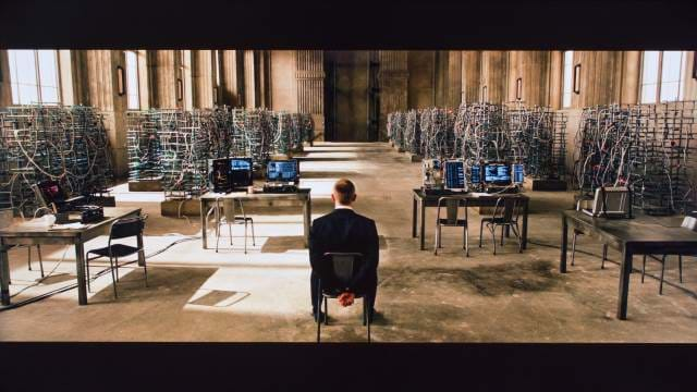 Skyfall - James Bond tied up with a room full of computers