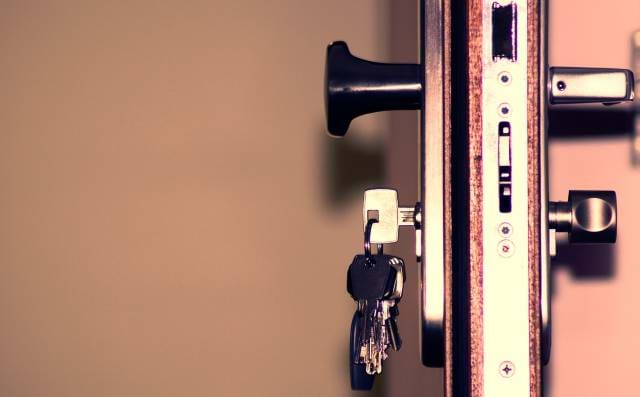 Side view of a door with mutiple locks