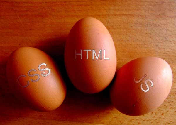 Three Eggs with the words HTML, CSS, and JavaScript on them.