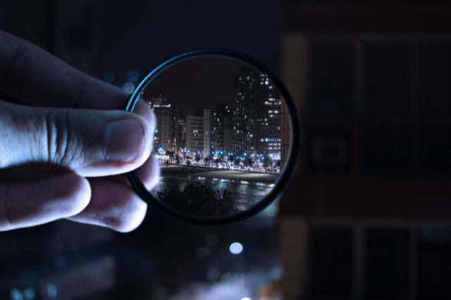 Image of Magnifying glass looking at a city