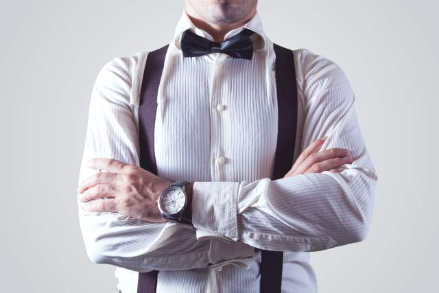 Business man with bowtie and suspenders