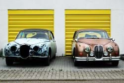 Two old cars that are similar, but different.