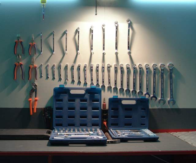 Collection of tools on a peg board.