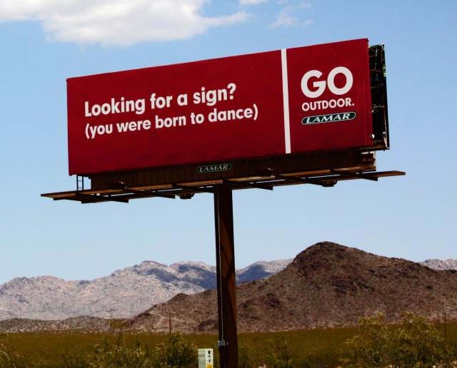 Billboard on the side of the road.