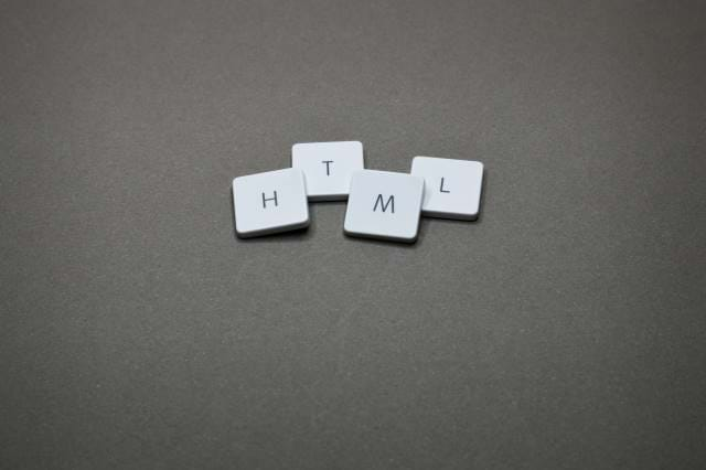 Scrabble pieces that spell HTML