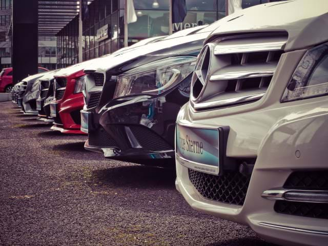 Cars lined up in a garage.