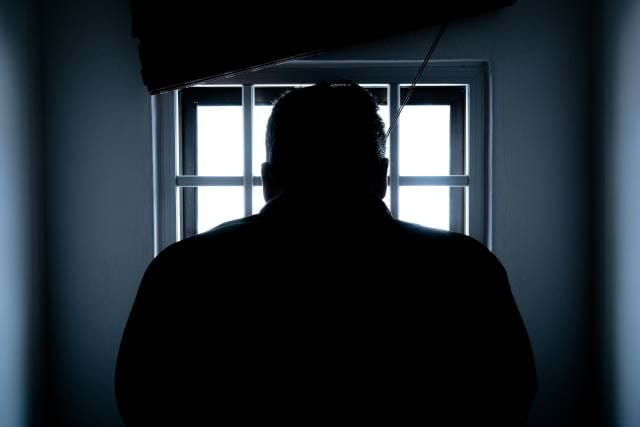 Man behind bars in jail