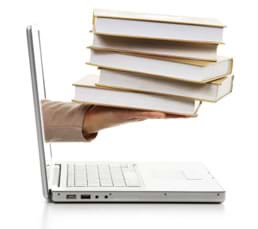 Hand with books coming out of a Laptop