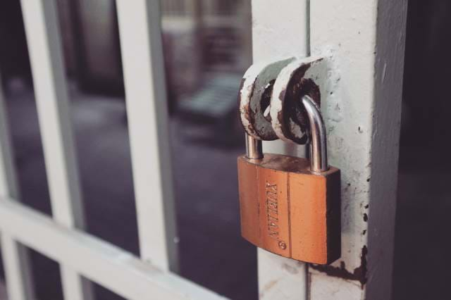 Picture of a Padlock on a fence