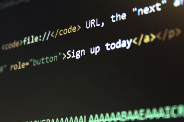 HTML code on a laptop screen