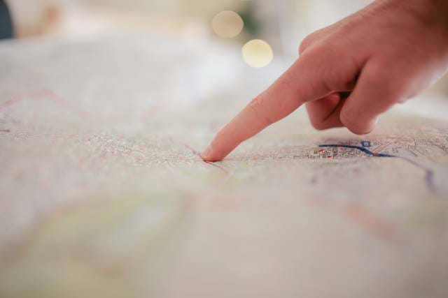 Hand pointing on a map