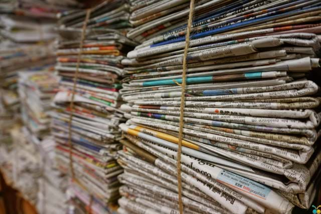 Newspapers bundled together with twine