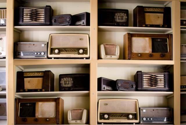 Shelf of old style radios