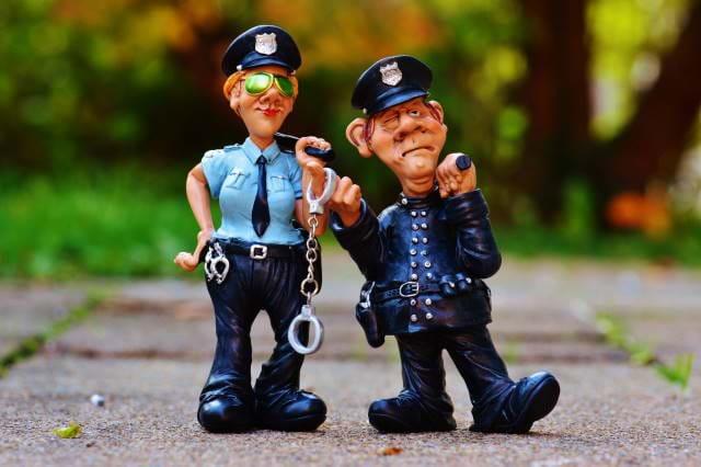 Ceramic Police on a sidewalk