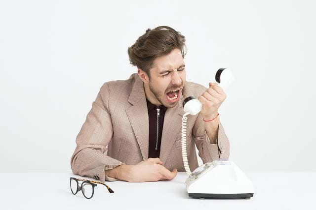 Man Screaming Into A Phone