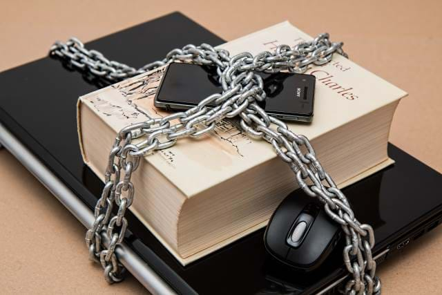 Secure Book, Laptop, Phone, and Mouse with a chain around everything