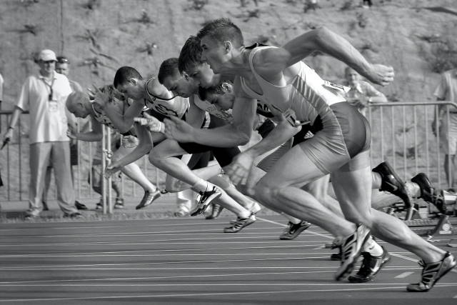 Line-up of runners starting a race.