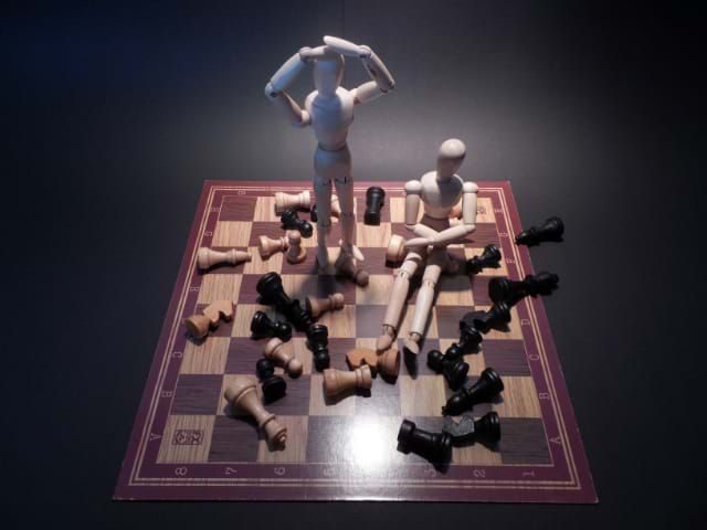 Marionettes causing a problem on a chess board