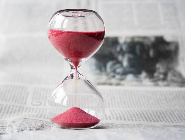 Hourglass containing red sand